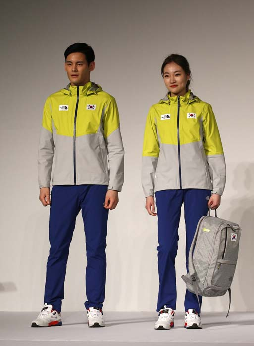 South Korean models present the South Korean Olympic team uniforms for the 2016 Rio de Janeiro Olympic Games at Korean National Training Center in Seoul, South Korea, Wednesday, April 27, 2016. South Korea's Olympic committee on Wednesday unveiled long-sleeved shirts and pants it says will help protect the country's Olympic athletes from the mosquito-borne Zika virus at this year's games in Rio de Janeiro. (AP Photo/Lee Jin-man)